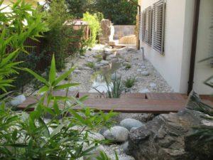 Projektowanie ogrodów japońskich fengshui - kamienna rzeka